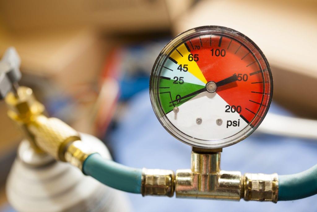 Service Industry: Pressure gauge in auto repair shop.