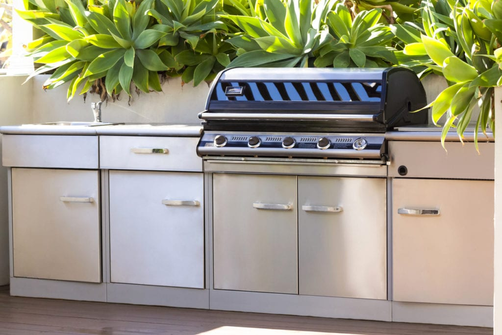 Modern stainless steel barbecue grill with staineless steel cupboards
