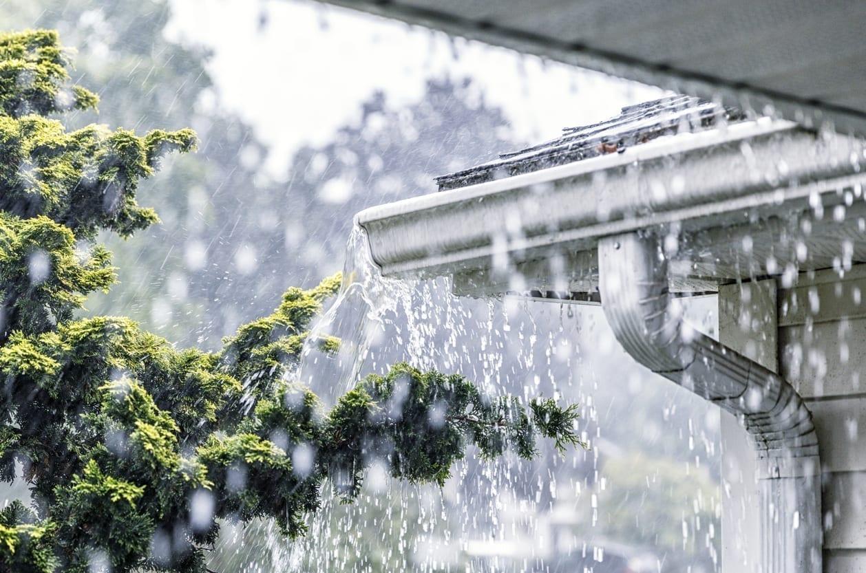 Torrential Summer Rain Storm Water Overflowing Roof Gutters