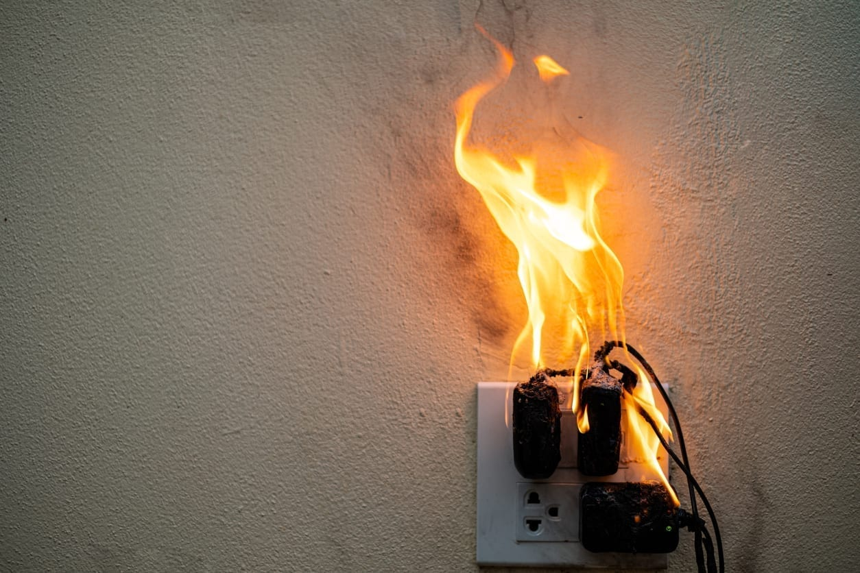 On fire adapter at plug Receptacle on white background