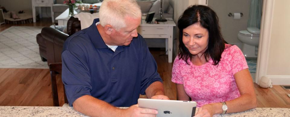 Woman with man on iPad